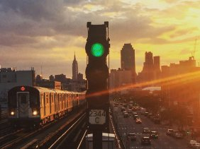 Private Walking Tour of Queens. Photo by Streetwise New York of 7 Train with the skyline